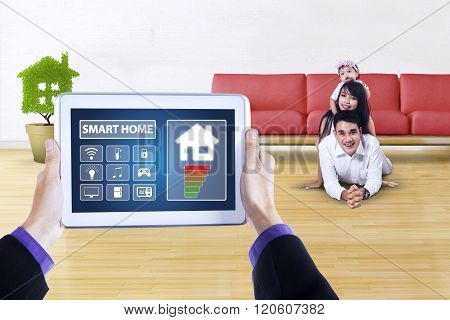 Tablet With Smart Home App And Happy Family