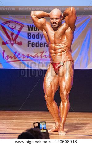 Male Bodybuilder Flexes His Muscles To Show His Physique
