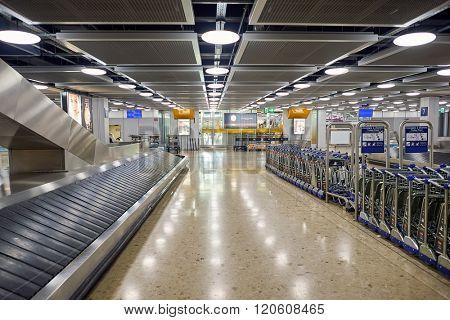GENEVA, SWITZERLAND - NOVEMBER 18, 2015: Baggage claim area in Geneva Airport. Geneva International Airport is the international airport of Geneva, Switzerland.
