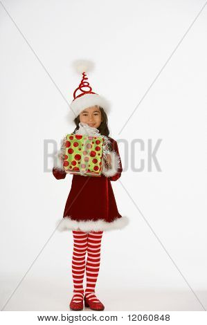 Portrait of girl dressed as elf holding gift