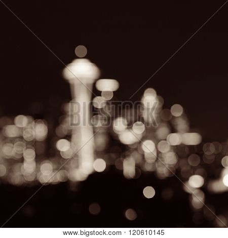 Seattle city skyline bokeh at night with urban office buildings viewed from Kerry Park.