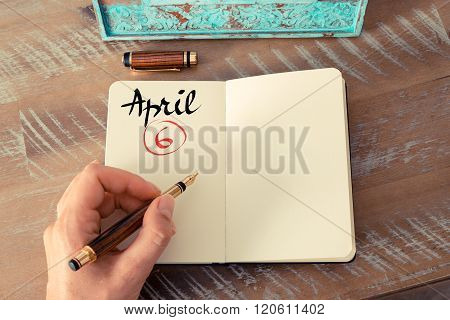 April 6 Calendar Day Handwritten On Notebook