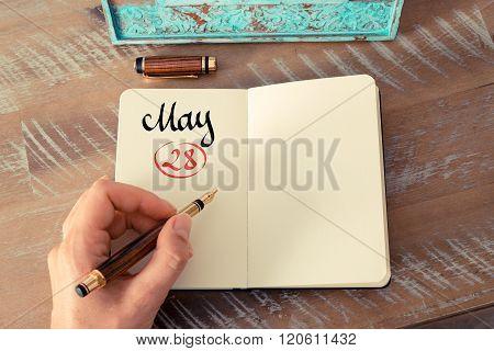 May 28 Calendar Day Handwritten On Notebook