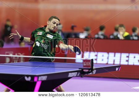 KUALA LUMPUR, MALAYSIA - MARCH 01, 2016: Marcos Freitas of Portugal plays return shot in his match in the Perfect 2016 World Team Table-tennis Championships held in Kuala Lumpur, Malaysia.