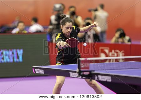 KUALA LUMPUR, MALAYSIA - MARCH 01, 2016: Claudia Caymel of Spain plays return shot in her match in the Perfect 2016 World Team Table-tennis Championships held in Kuala Lumpur, Malaysia.