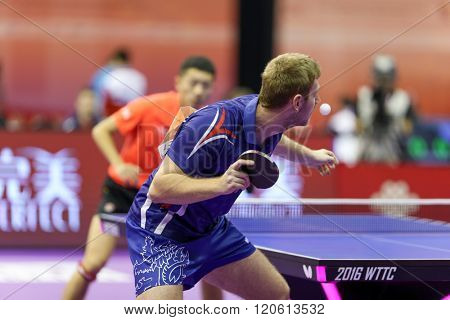 KUALA LUMPUR, MALAYSIA - MARCH 01, 2016: Pavel Sirucek of the Czech Republic serves the ball in his match in the Perfect 2016 World Team Table-tennis Championships held in Kuala Lumpur, Malaysia.