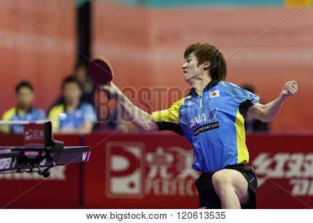KUALA LUMPUR, MALAYSIA - MARCH 01, 2016: Kenta Matsudiara of Japan smashes a return in his match in the Perfect 2016 World Team Table-tennis Championships held in Kuala Lumpur, Malaysia.