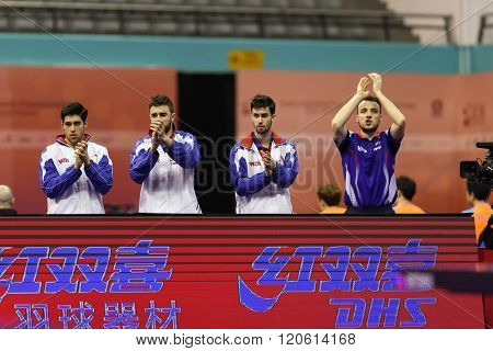 KUALA LUMPUR, MALAYSIA - MARCH 01, 2016: The France team cheers Emmanuel Lebesson on in his match in the Perfect 2016 World Team Table-tennis Championships held in Kuala Lumpur, Malaysia.