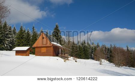 Wooden rustic cottage for rent in mountain resort in Czechia