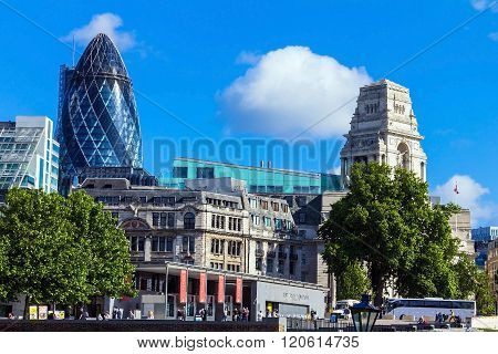 LONDON UK - JUNE 6 2015: Clouds floating over the City of London with a Gherkin building (30 St Mary Axe)