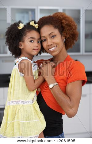 Mother and daughter smiling for the camera