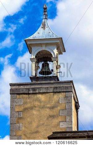 LONDON, UK - JUNE 6, 2015: Watchdog bell on top of the Watchtower of the Tower of London castle on blue sky background
