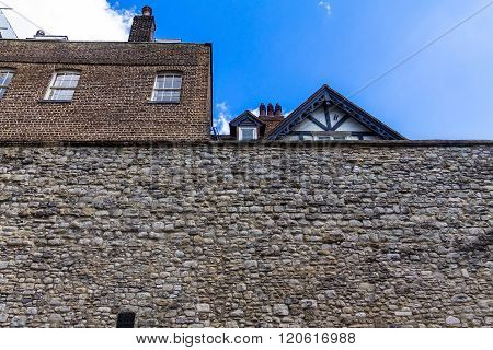 LONDON UK - JUNE 6 2015 : Stone walls at Tower of London historic castle on the north bank of the River Thames in central London - a popular tourist attraction