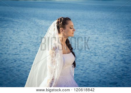 Bride standing near the river