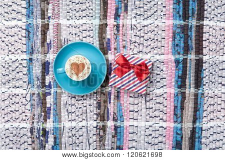 Cup And Gift On The Table