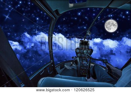 Cockpit in cloudy sky at night