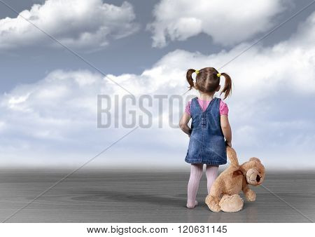 Child Girl With Toy Bear Looking Into The Distance, Perception Concept