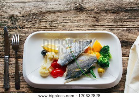 fish fillet with stewed vegetables. lenten food
