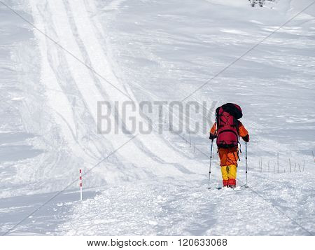Climbing lone alpinist in the Caucasus mountains Elbrus climb up the trail snowcat