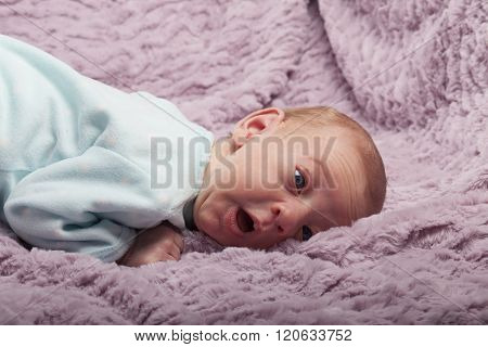 Adorable Newborn Baby With Funny Face