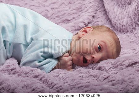 Surprised Newborn Baby Looking Up