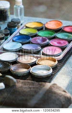 Canisters Of Oil Paints At Carnival Face Painting Station