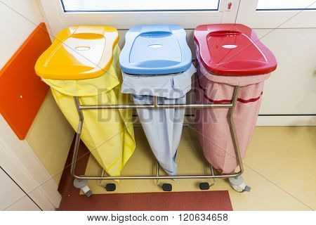 Three Recycle Bins In A Hospital