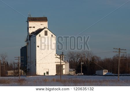 White Grain Elevator At Sunset