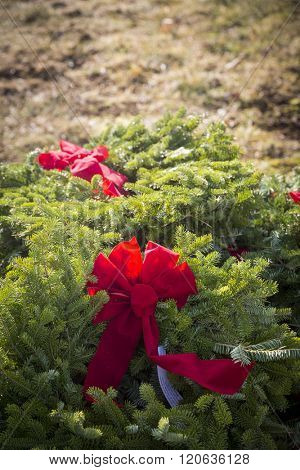 SUCCASUNNA, NJ-DEC 12, 2015: A red bow fastened to wreaths that will be laid on veterans graves during the 2015 nationwide Wreaths Across America event.