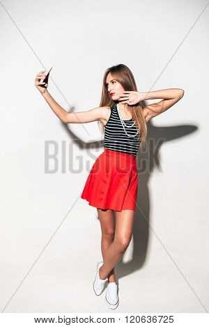 Girl in marine style with mobile phone