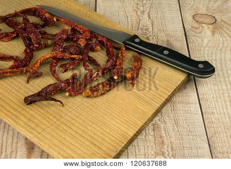 Dried Chilli Peppers On The Old Worktop
