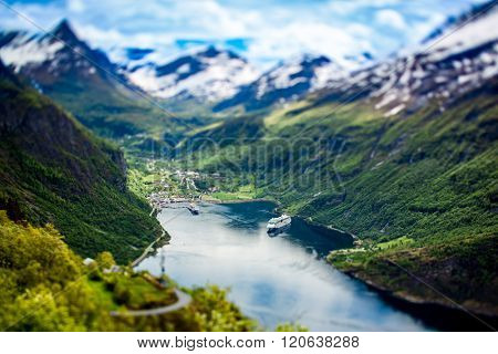 Geiranger fjord, Beautiful Nature Norway (tilt shift lens). It is a 15-kilometre (9.3 mi) long branch off of the Sunnylvsfjorden, which is a branch off of the Storfjorden (Great Fjord).