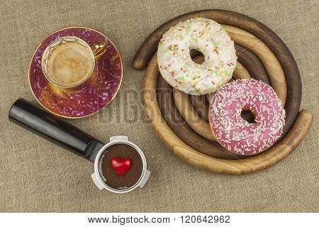 Sweet breakfast. Fresh coffee and a donut. Sweet treats to hot coffee.