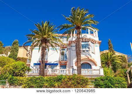 Villefranche-sur-Mer, France - March 3, 2016: View of beautiful landscape with Mediterranean luxury resort. Villefranche-sur-Mer Nice Cote d'Azur French Riviera.