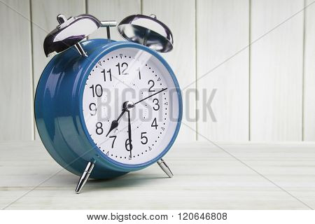 classic blue alarm clock morning wake-up time