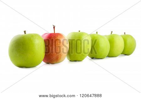 Red Apple In A Row Of Green Apples