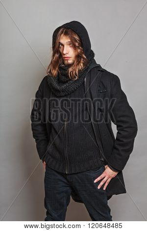 Handsome Fashion Man Portrait Wearing Black Coat.