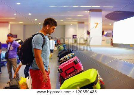 Young Adult Man, Passenger Waiting For Luggage In Airport Terminal