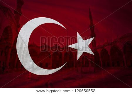 Turkish flag with view of Blue mosque courtyard in Istanbul seen in background