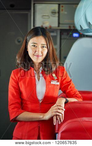 PATTAYA, THAILAND - FEBRUARY 26, 2016: crew member of Thai AirAsia A320. Thai AirAsia is a joint venture of Malaysian low-fare airline AirAsia and Thailand's Asia Aviation