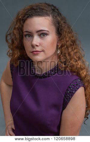 Serious teen beauty in purple dress