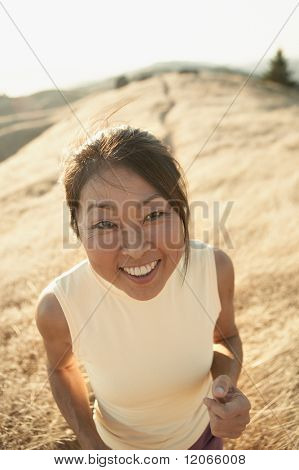 Senior woman smiling for the camera outdoors