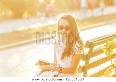 Hipster Girl Holding Book And Telephone.
