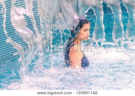 Woman Refreshment With Water Stream Swimming Pool In Summer.