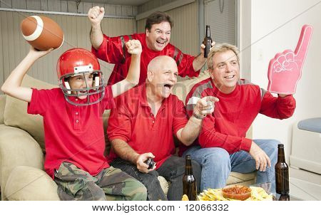 Excited football fans watching their team score a touchdown.
