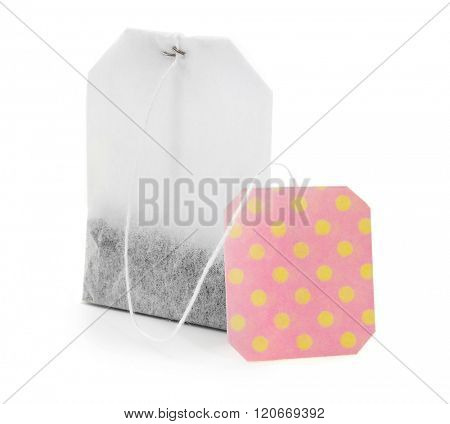 Teabag with red dotted label isolated on white background
