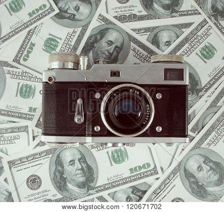 Background With Money American Hundred Dollar And Old Photo Camera