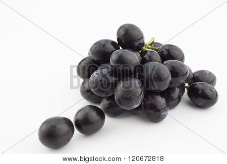 Small Bunch Of Black Grapes Isolated On White Background