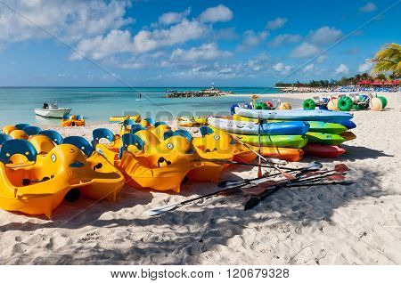 Colorful Water Sport Equipments On The Beach - Bahamas