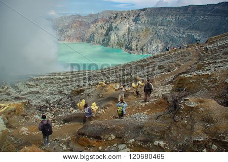 Unidentified People Mining Sulfur From  The Active Volcano Of Mt.kawah Ijen